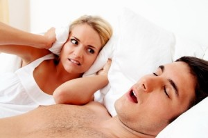Sleep apnea is often first noticed by a partner in the form of loud breathing or snoring.